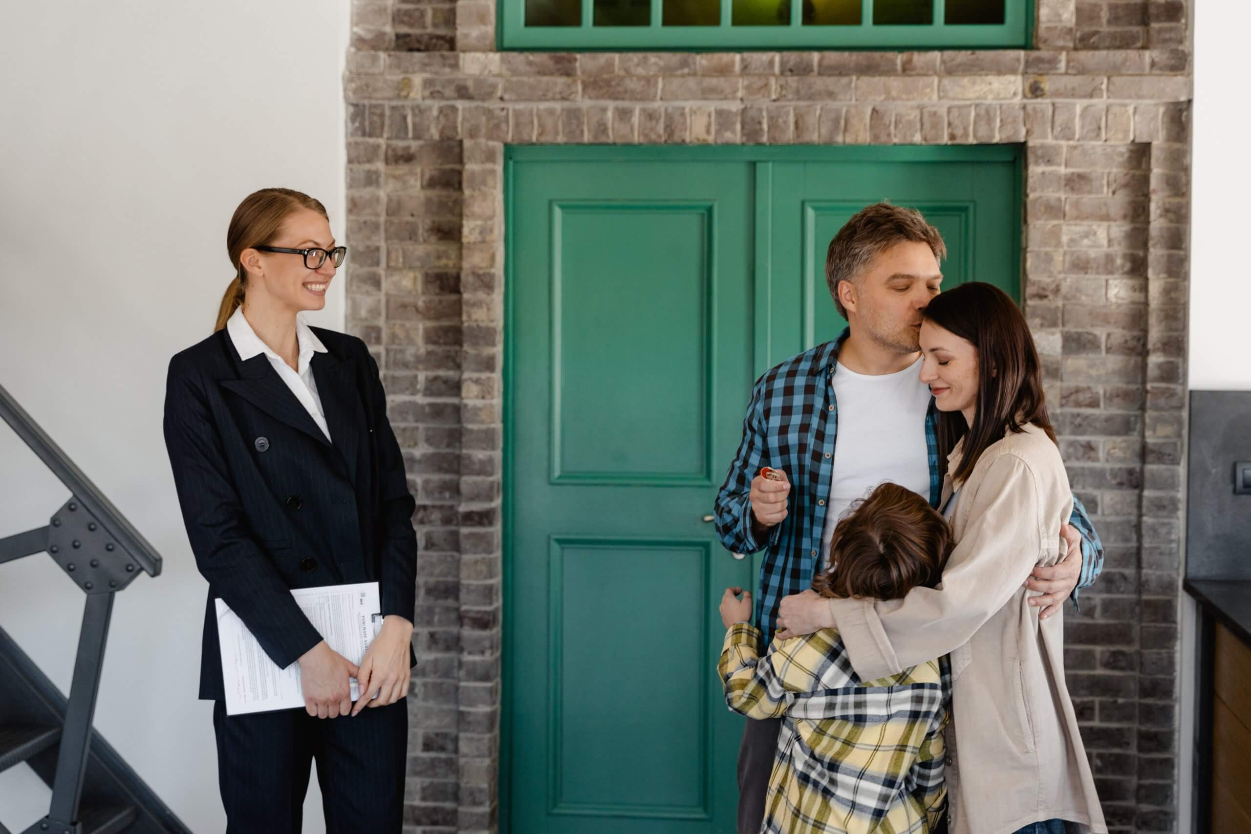 real estate agent showing a house